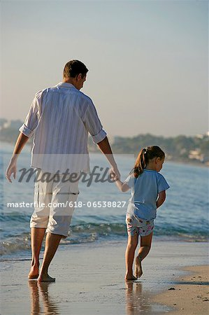 father and daughter on the beach Stock Photo - Premium Royalty-Free, Image code: 618-06538827