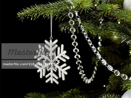 Beaded Snowflake Decoration Stock Photo - Premium Royalty-Free, Image code: 618-06618208