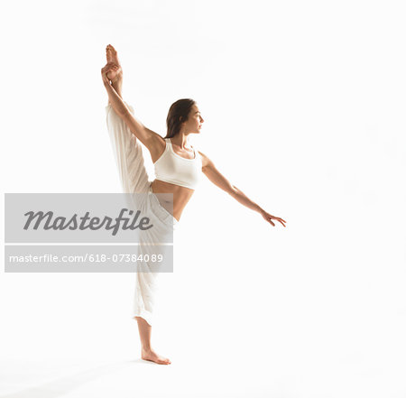 Young woman exercising. Stock Photo - Premium Royalty-Free, Image code: 618-07384089