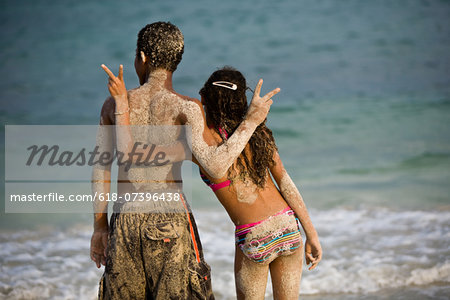 Couple doing peace sign while boy looks away Stock Photo - Premium Royalty-Free, Image code: 618-07396438