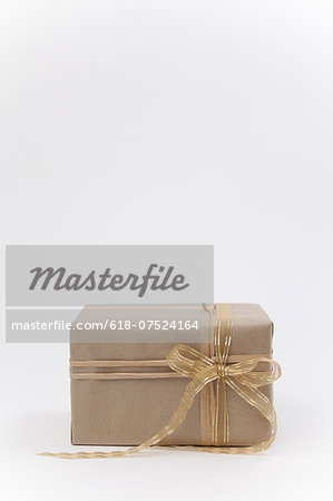Brown paper package with ribbon. Stock Photo - Premium Royalty-Free, Image code: 618-07524164