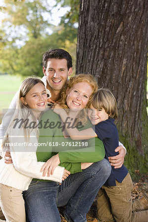 Portrait of family in autumn forest Stock Photo - Premium Royalty-Free, Image code: 618-07612198
