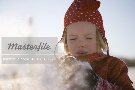 Girl blowing snow, close up Stock Photo - Premium Royalty-Free, Image code: 618-07612282