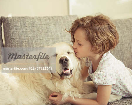 Young girl kissing pet dog Stock Photo - Premium Royalty-Free, Image code: 618-07612342