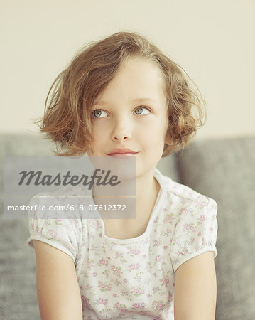 Young girl looking up Stock Photo - Premium Royalty-Free, Image code: 618-07612372