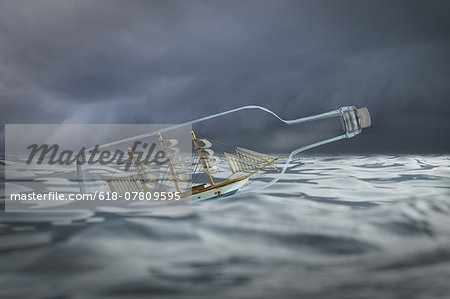Ship in a bottle in rough waters Stock Photo - Premium Royalty-Free, Image code: 618-07809595