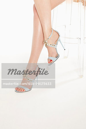 Young woman wearing high heels, low section Stock Photo - Premium Royalty-Free, Image code: 618-08173633