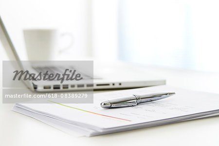 still life of pen and laptop Stock Photo - Premium Royalty-Free, Image code: 618-08389279