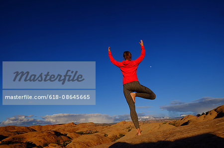 Woman doing yoga on Slickrock in Moab Stock Photo - Premium Royalty-Free, Image code: 618-08645665