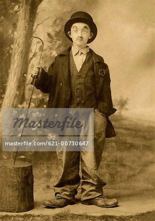 Child in charlie chaplin costume stock photo premium royalty free