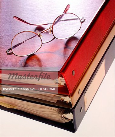 Glasses on binders Stock Photo - Premium Royalty-Free, Image code: 621-00740968
