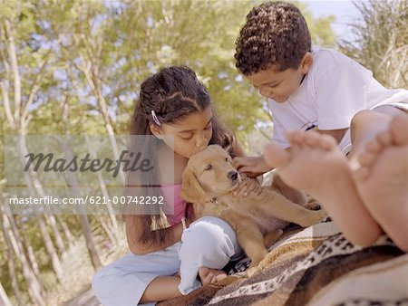 Kids with Puppy Stock Photo - Premium Royalty-Free, Image code: 621-00742292