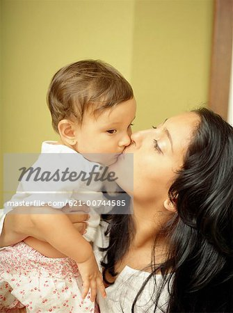 Kissing mother and baby Stock Photo - Premium Royalty-Free, Image code: 621-00744585