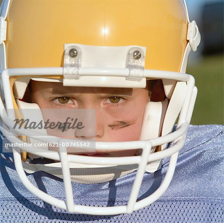 Serious Pee Wee Leaguer Stock Photo - Premium Royalty-Free, Image code: 621-00745542