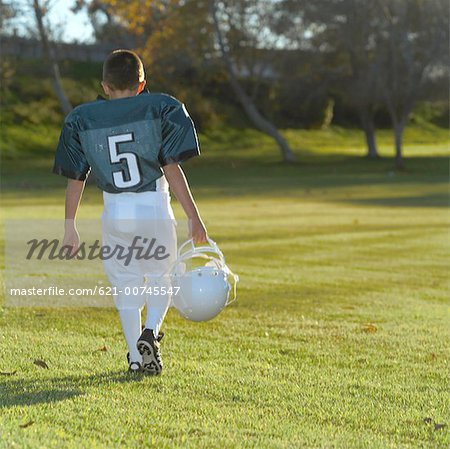 Defeated Pee Wee Leaguer Stock Photo - Premium Royalty-Free, Image code: 621-00745547