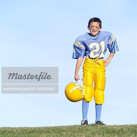 Pee Wee Football Player Stock Photo - Premium Royalty-Free, Image code: 621-00745552