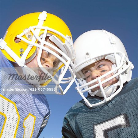 Pee Wee Leaguers Butting Heads Stock Photo - Premium Royalty-Free, Image code: 621-00745556