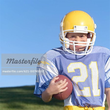 Aggressive Pee Wee Leaguer Stock Photo - Premium Royalty-Free, Image code: 621-00745557