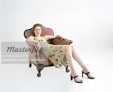 Woman Lounging in Antique Chair Stock Photo - Premium Royalty-Free, Image code: 621-00789100