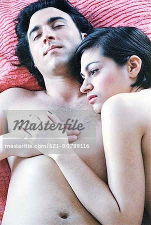 Pensive Young Couple in Bed Stock Photo - Premium Royalty-Free, Image code: 621-00789116