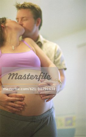 Pregnant Couple Kissing Stock Photo - Premium Royalty-Free, Image code: 621-00790638