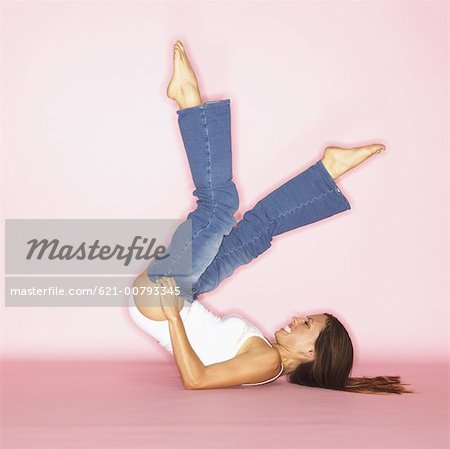 Young Lady Trying to Fit Into Her Jeans Stock Photo - Premium Royalty-Free, Image code: 621-00793345