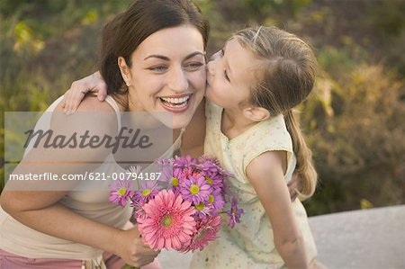 Little Girl Giving Loving Kiss to Mother Stock Photo - Premium Royalty-Free, Image code: 621-00794187