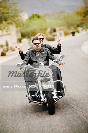 Biker Couple in Leather Riding on Motorcycle