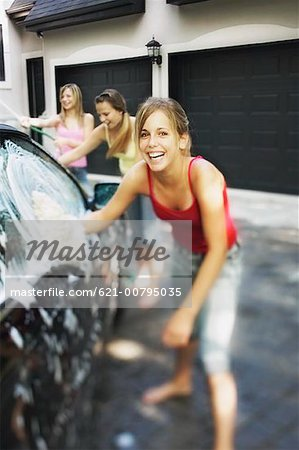 Three Girls Washing Car Stock Photo - Premium Royalty-Free, Image code: 621-00795035