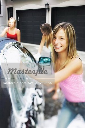 Three Girls Washing Car Stock Photo - Premium Royalty-Free, Image code: 621-00795036