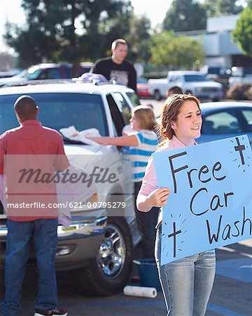 Church Youth Group Holding Car Wash Stock Photo - Premium Royalty-Free, Image code: 621-00795279