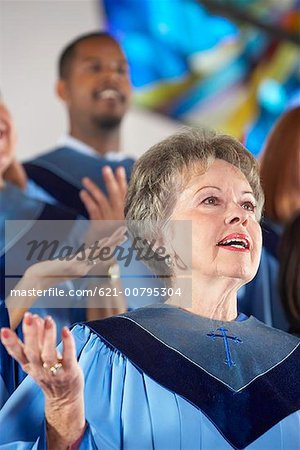Church Choir with Palms Raised Stock Photo - Premium Royalty-Free, Image code: 621-00795304