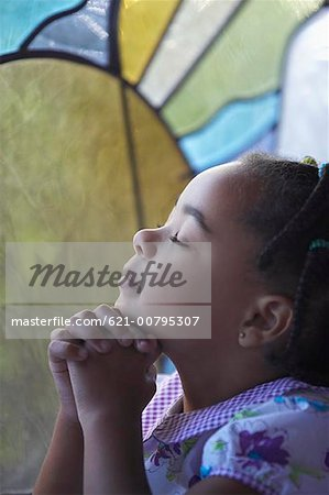 Three Year Old Girl Praying with Eyes Closed Stock Photo - Premium Royalty-Free, Image code: 621-00795307