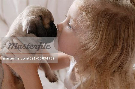 Girl kissing puppy Stock Photo - Premium Royalty-Free, Image code: 621-00894939
