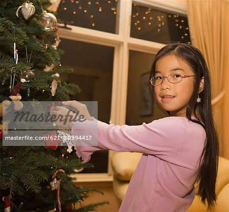 Preteen Female Decorating Christmas Tree Stock Photo - Premium Royalty ...