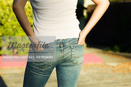 Woman's Rear End in Jeans Stock Photo - Premium Royalty-Free, Image code: 621-00994694