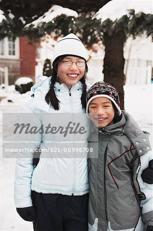 Portrait of Teen Female and Preteen Male in Winter Attire Stock Photo - Premium Royalty-Free, Image code: 621-00996708