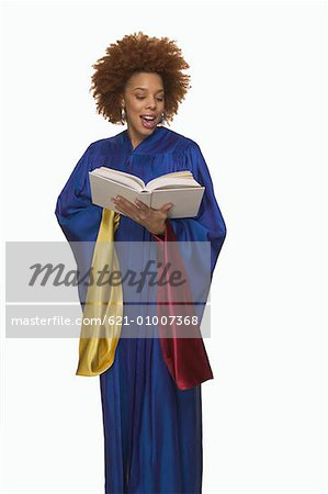 Gospel Singer Singing from Hymnal Stock Photo - Premium Royalty-Free, Image code: 621-01007368