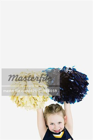 Little Girl Dressed as Cheerleader Stock Photo - Premium Royalty-Free, Image code: 621-01008059