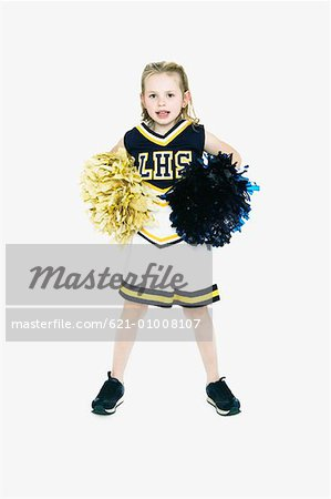 Little Girl in Cheerleader Costume Stock Photo - Premium Royalty-Free, Image code: 621-01008107