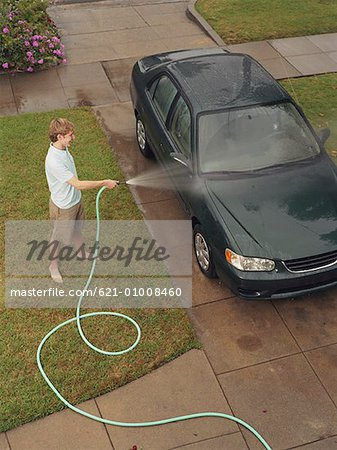Teen Boy Washing Car Stock Photo - Premium Royalty-Free, Image code: 621-01008460