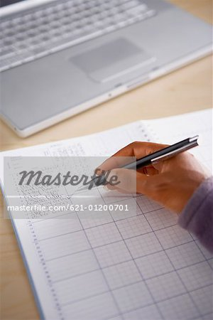Hand of teacher grading papers Stock Photo - Premium Royalty-Free, Image code: 621-01200701