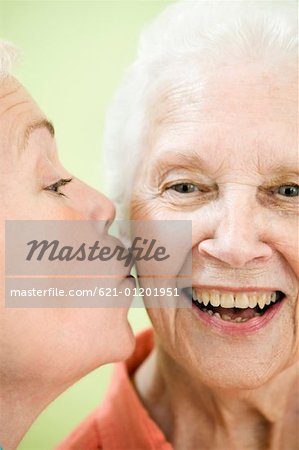 Daughter kissing mother Stock Photo - Premium Royalty-Free, Image code: 621-01201951