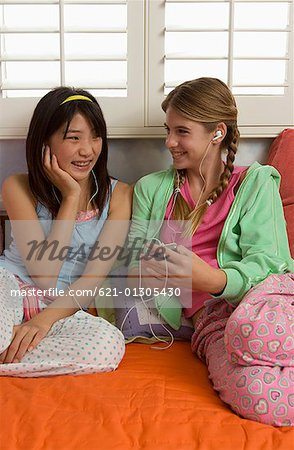 Preteen girls sharing MP3 player Stock Photo - Premium Royalty-Free ...