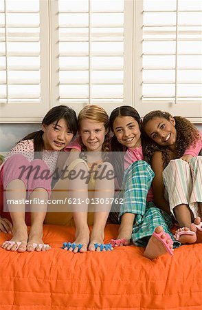 Four preteen girls at slumber party