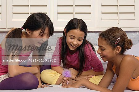 Preteen girls writing a note Stock Photo - Premium Royalty-Free, Code ...