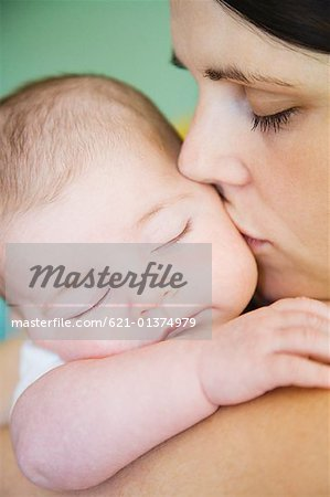 Loving mother with sleeping infant Stock Photo - Premium Royalty-Free, Image code: 621-01374979