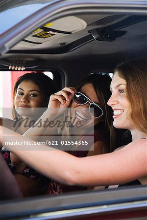 Group of friends in SUV Stock Photo - Premium Royalty-Free, Image code: 621-01554365