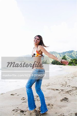Smiling teenage girl on beach Stock Photo - Premium Royalty-Free, Image code: 621-01554373