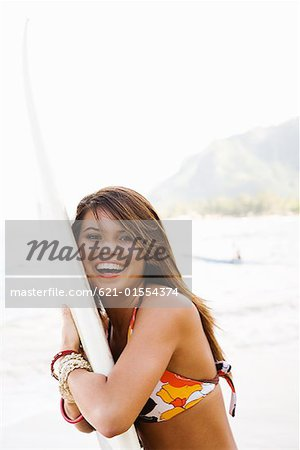 Teenage girl holding surfboard Stock Photo - Premium Royalty-Free, Image code: 621-01554374